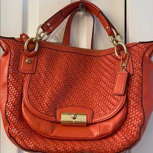 Orange coach handbag   luxury